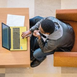 Photo of student using laptop viewed from overhead