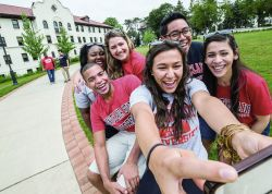 Group photo of students taking a selfie in front of Chapin Hall