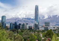 Photo of business buildings in Santiago, Chile set against a mountain range.