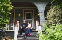 Photo of two New Jersey voters sitting on their front porch