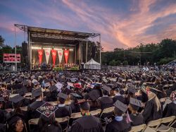 Photo of 2018 Feliciano School of Business evening outdoor Convocation ceremony.