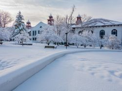 College Hall and surrounding campus area blanketed in snow.