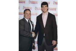 Russ Romeo and Eli Manning shaking hands