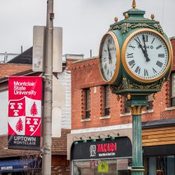 Clock and montclair state banner in uptown Montclair