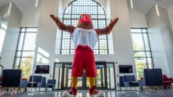 Rocky standing in the new atrium at college hall