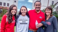 mother, father and two daughters in MSU apparel on campus